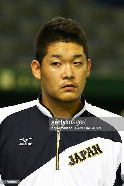 Yoshitomo Tsutsugoh of Japan looks on a training session ahead of the WBSC Premier 12 semi final match against South Korea at the Tokyo Dome on...