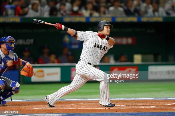 Yoshitomo Tsutsugoh of Team Japan hits an RBI single in the first inning during the Game 1 of Pool B against Team Cuba at the Tokyo Dome on Tuesday...