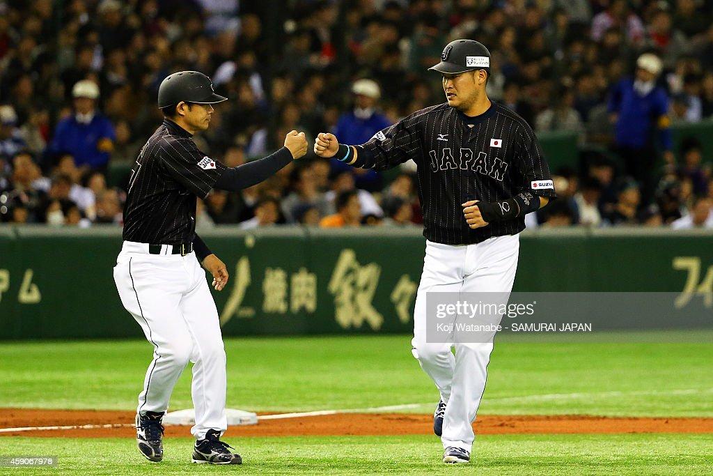 Yoshitomo Tsutsugou of Samurai Japan celebrates after hitting an RBI double in the second inning during the game four of Samurai Japan and MLB All...