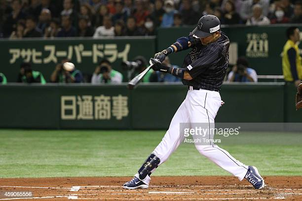 Yoshitomo Tsutsugou of Samurai Japan hits an RBI double in the second inning during the game four of Samurai Japan and MLB All Stars at Tokyo Dome on...