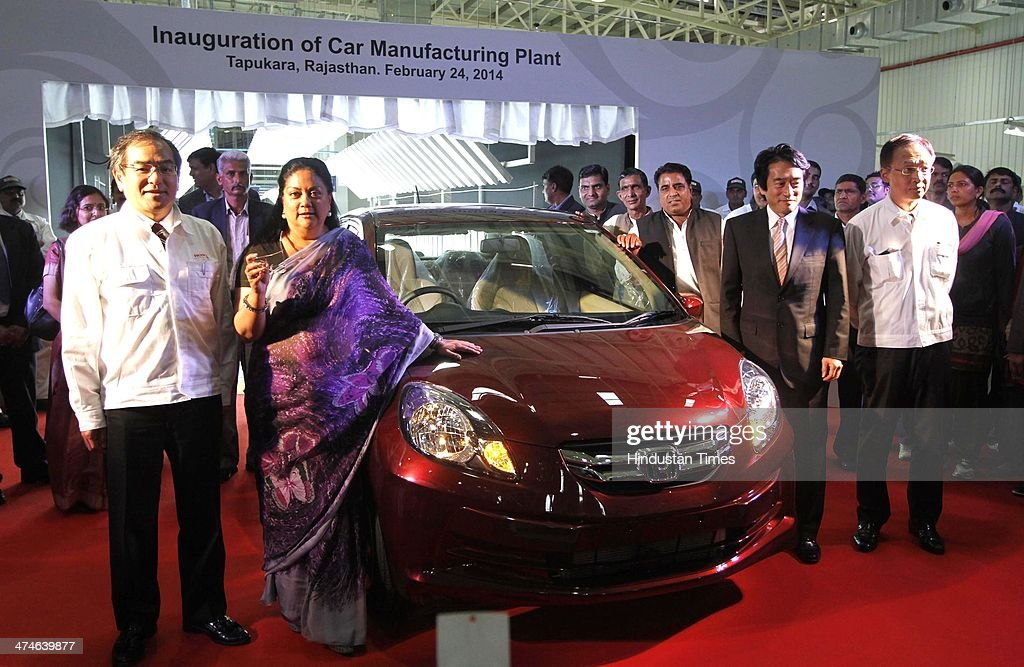 Yoshiyki Matsumoto Mangaing Officer of Honda Motors Co, Japan, Rajasthan Chief Minister Vasundhara Raje Scindia, Yasuhisa Kawamura Deputy Chief of Mission Japan Embassy, Hironori Kanayama President and CEO of Honda Cars India, posing with the Car at the newly inaugurated Honda Car Plant, which has started its car production from Tapukara Plant on February 24, 2014 in Alwar, India. The Rs 3,520-crore plant, which has a total production capacity of 1.2 lakh cars per annum, effectively doubles the companys total manufacturing capacity to 2.4 lakh cars per annum.
