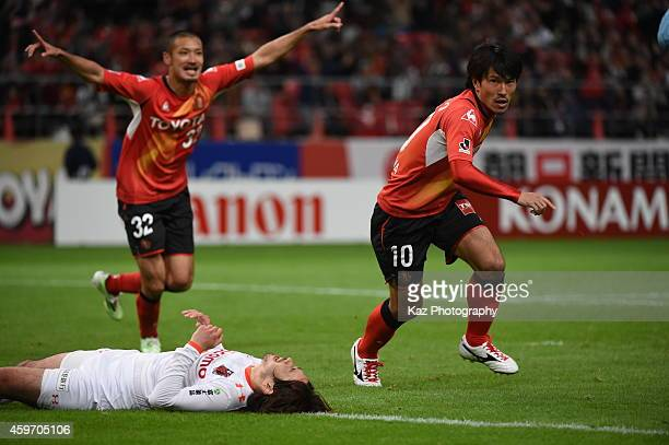 Yoshizumi Oagawa of Nagoya Grampus celebrates 2nd goal of the team with Kengo Kawamata of Nagoya Grampus during the JLeague match between Nagoya...