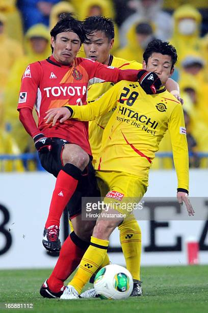 Yoshizumi Ogawa of Nagoya Grampus and Ryoichi Kurisawa of Kashiwa Reysol compete for the ball during the JLeague match between Kashiwa Reysol and...