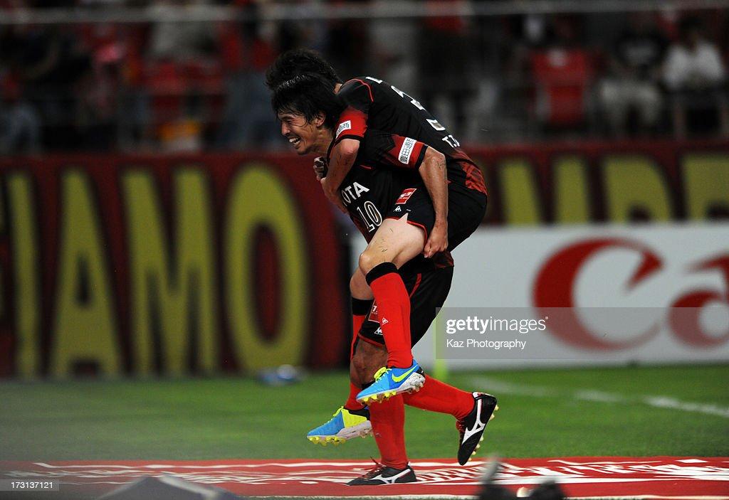 Yoshizumi Ogawa of Nagoya Grampus celebrates scoring his team's second goal with his team mate Hayuma Tanaka during the JLeague match between Nagoya...