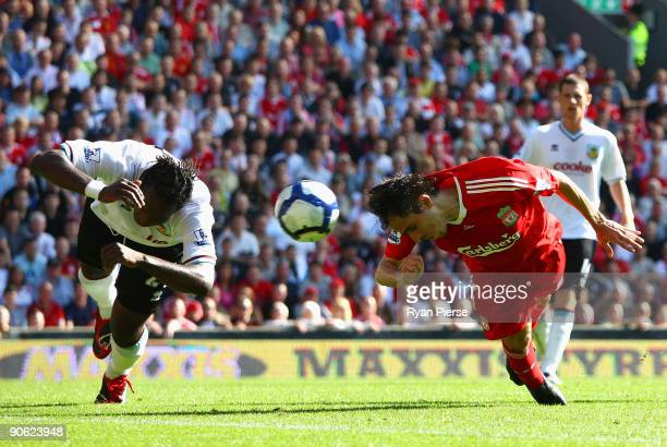 Yossi Benayoun heads at goal past Andre Bikey of Burnley during the Barclays Premier League match between Liverpool and Burnley at Anfield on...