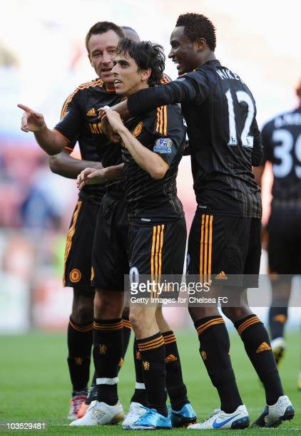 Yossi Benayoun of Chelsea celebrates with John Terry and John Obi Mikel as he scores their sixth goal during the Barclays Premier League match...