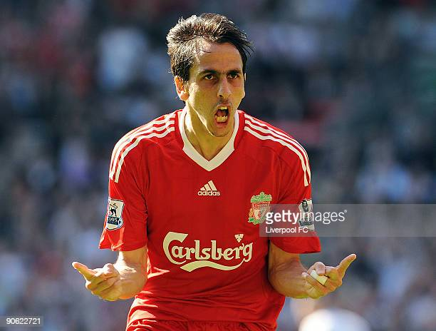Yossi Benayoun of Liverpool celebrates after scoring the first goal during the Barclays Premier League match between Liverpool and Burnley at Anfield...