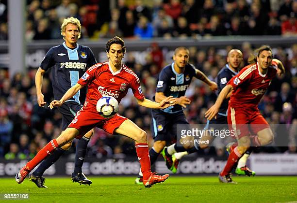 Yossi Benayoun of Liverpool scores the opening goal during the Barclays Premier League match between Liverpool and West ham United at Anfield on...