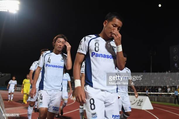 Yosuke Ideguchi and Gamba Osaka players show dejection after their 01 defeat in the JLeague J1 match between Ventforet Kofu and Gamba Osaka at...