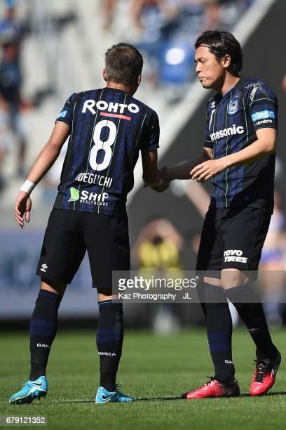 Yosuke Ideguchi and Yasuhito Endo of Gamba Osaka are seen during the JLeague J1 match between Gamba Osaka and Shimizu SPulse at Suita City Football...