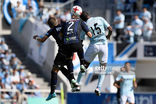 Yosuke Ideguchi Genta Miura of Gamba Osaka and Adailton of Jubilo Iwata compete for the ball during the JLeague J1 match between Jubilo Iwata and...