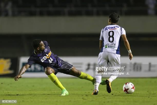 Yosuke Ideguchi of Gamba Osaka and Anderson Lopes of Sanfrecce Hiroshima compete for the ball during the JLeague J1 match between Sanfrecce Hiroshima...
