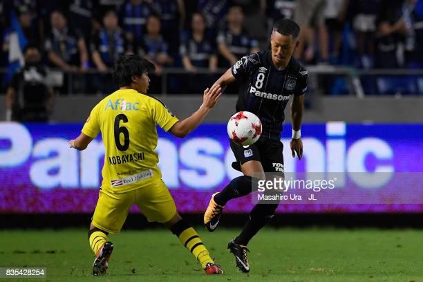 Yosuke Ideguchi of Gamba Osaka and Yusuke Kobayashi of Kashiwa Reysol compete for the ball during the JLeague J1 match between Gamba Osaka and...