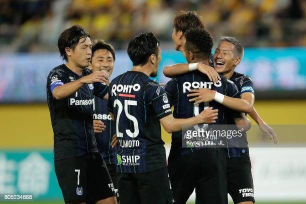 Yosuke Ideguchi of Gamba Osaka celebrates scoring his side's second goal with his team mates during the JLeague J1 match between Vegalta Sendai and...