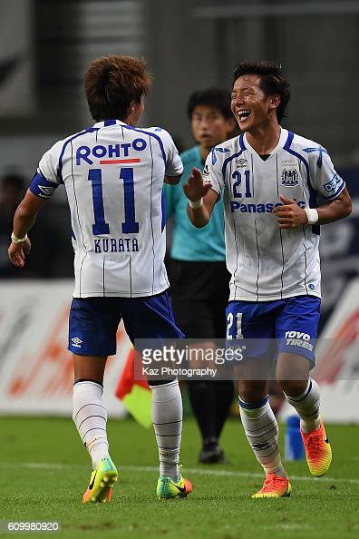 Yosuke Ideguchi of Gamba Osaka celebrates their third goal with Shu Kurata of Gamba Osaka during the J League match between Nagoya Grampus and Gamba...