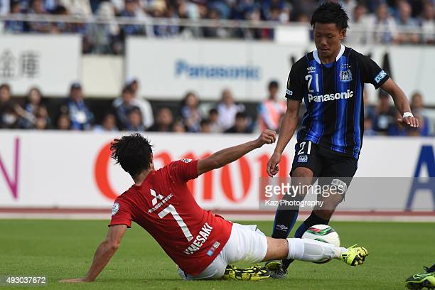 Yosuke Ideguchi of Gamba Osaka escapes the challenge from Tsukasa Umesaki of Urawa Reds on October 17 2015 in Osaka Japan