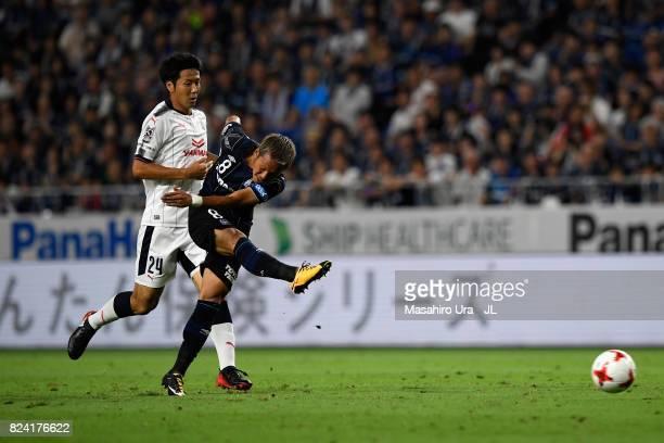 Yosuke Ideguchi of Gamba Osaka shoots at goal during the JLeague J1 match between Gamba Osaka and Cerezo Osaka at Suita City Football Stadium on July...