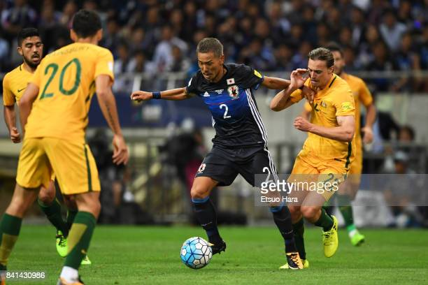 Yosuke Ideguchi of Japan and Jackson Irvine of Australia compete for the ball during the FIFA World Cup Qualifier match between Japan and Australia...