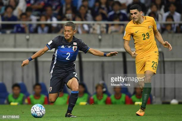 Yosuke Ideguchi of Japan and Tomas Rogic of Australia compete for the ball during the FIFA World Cup Qualifier match between Japan and Australia at...