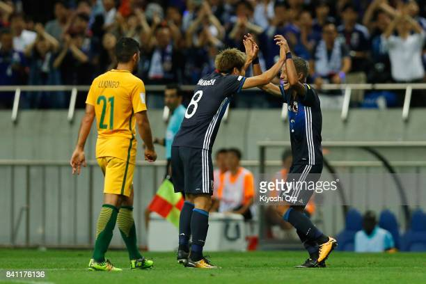 Yosuke Ideguchi of Japan celebrates scoring his side's second goal with his team mate Genki Haraguchi during the FIFA World Cup Qualifier match...