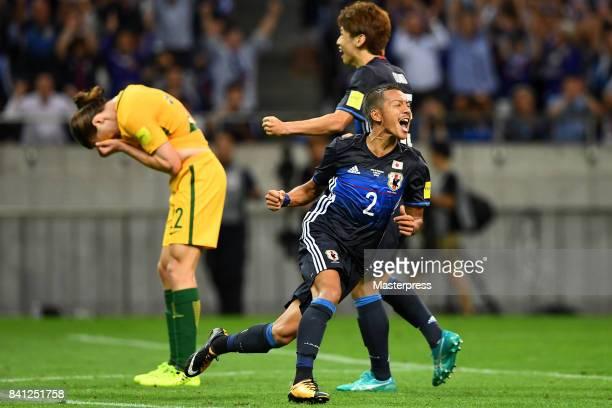 Yosuke Ideguchi of Japan celebrates scoring his side's second goal while Jackson Irvine of Australia shows dejection during the FIFA World Cup...