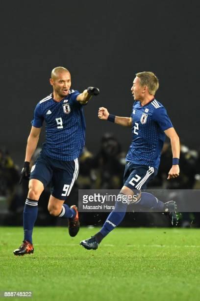 Yosuke Ideguchi of Japan celebrates scoring the opening goal with his team mate Kengo Kawamata during the EAFF E1 Men's Football Championship between...