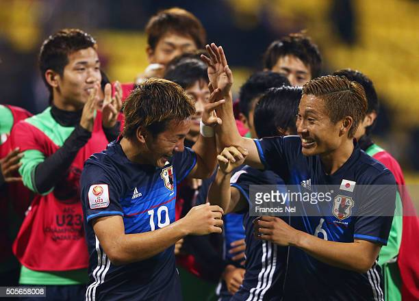 Yosuke Ideguchi of Japan celebrates with Ryosuke Yamanaka and team mates as he scores their second goal during the AFC U23 Championship Group B...