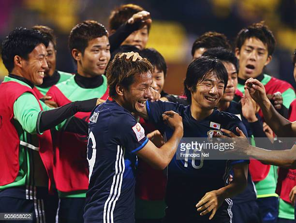 Yosuke Ideguchi of Japan celebrates with Shoya Nakajima and team mates as he scores their second goal during the AFC U23 Championship Group B match...