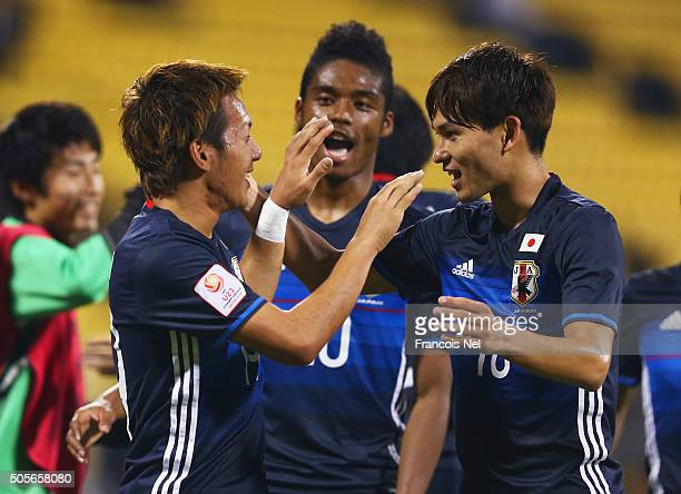 Yosuke Ideguchi of Japan celebrates with team mates as he scores their second goal during the AFC U23 Championship Group B match between Saudi...