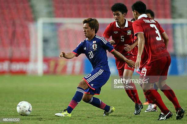Yosuke Ideguchi of Japan competes for the ball against Thailand during the friendly international match between Japan U21 and Thailand U21 at...
