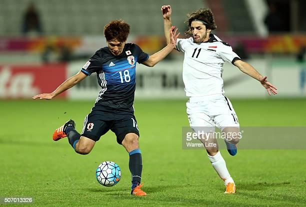 Yosuke Ideguchi of Japan in action during the AFC U23 Championship semi final match between Japan and Iraq at the Abdullah Bin Khalifa Stadium on...