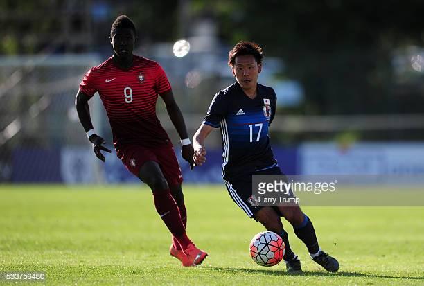 Yosuke Ideguchi of Japan looks to break past Joao Silva of Portugal during the Toulon Tournament match between Japan and Portugal at Stade De Lattre...