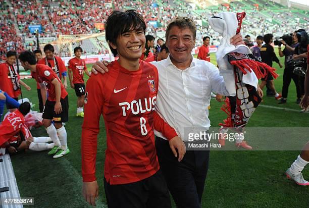 Yosuke Kashiwagi and Mihailo Petrovic of Urawa Red Diamonds celebrate winning the JLeague first stage after the JLeague match between Vissel Kobe and...