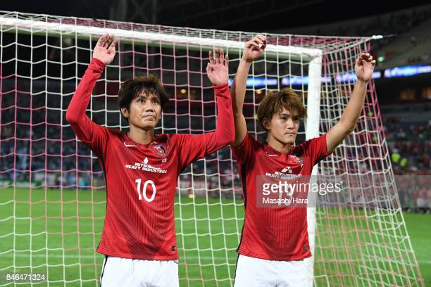 Yosuke Kashiwagi and Toshiyuki Takagi of Urawa Red Diamonds celebrate the win after the AFC Champions League quarter final second leg match between...