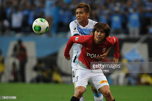 Yosuke Kashiwagi of Urawa Red Diamonds and Junichi Inamoto of Kawasaki Frontale tussle for the ball during the Yamazaki Nabisco Cup semi final second...