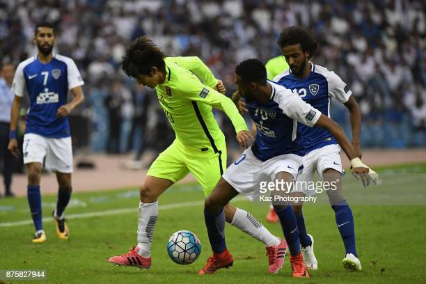 Yosuke Kashiwagi of Urawa Red Diamonds and Mohammed Jahfali of AlHilal compete for the ball during the AFC Champions League Final 2017 first leg...