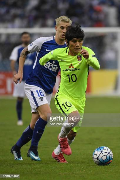 Yosuke Kashiwagi of Urawa Red Diamonds and Nicolas Milesi of AlHilal compete for the ball during the AFC Champions League Final 2017 first leg...