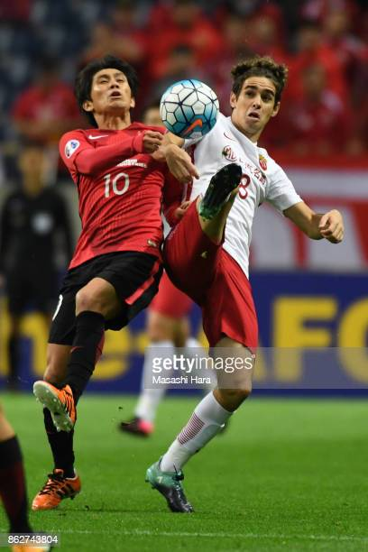 Yosuke Kashiwagi of Urawa Red Diamonds and Oscar of Shanghai SIPG compete for the ball during the AFC Champions League semi final second leg match...
