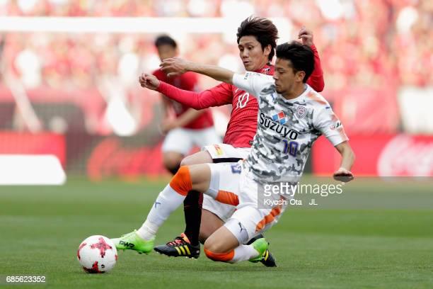 Yosuke Kashiwagi of Urawa Red Diamonds and Ryohei Shirasaki of Shimizu SPulse compete for the ball during the JLeague J1 match between Urawa Red...