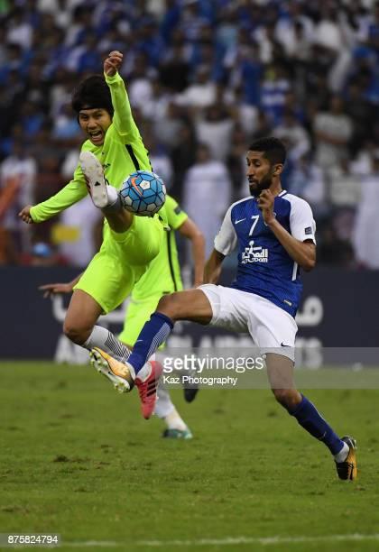 Yosuke Kashiwagi of Urawa Red Diamonds and Salman Al Faraj of AlHilal compete for the ball during the AFC Champions League Final 2017 first leg...