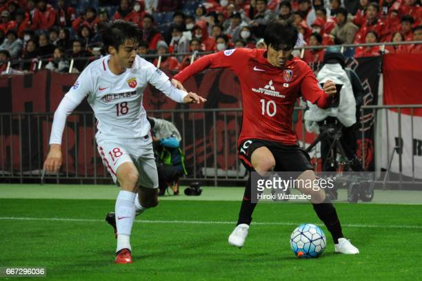 Yosuke Kashiwagi of Urawa Red Diamonds and Zhang Yi of Shanghai SIPG FC compete for the ball during the AFC Champions League Group F match between...