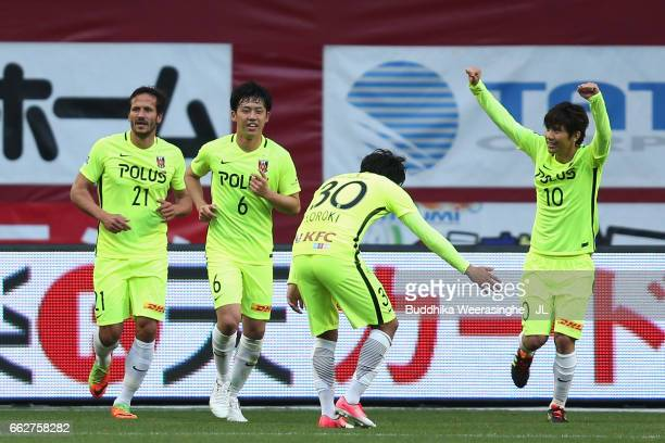Yosuke Kashiwagi of Urawa Red Diamonds celebrates scoring his side's third goal with his team mates during the JLeague J1 match between Vissel Kobe...