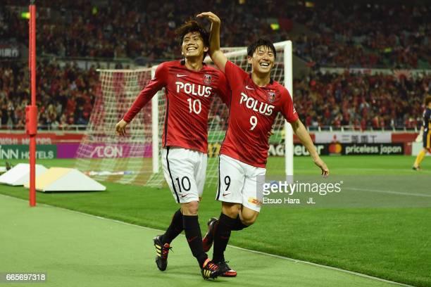 Yosuke Kashiwagi of Urawa Red Diamonds celebrates scoring his side's seventh goal with his team mate Yuki Muto during the JLeague J1 match between...