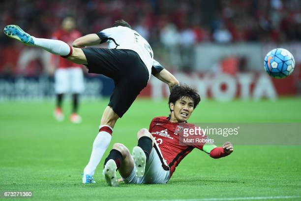 Yosuke Kashiwagi of Urawa Red Diamonds competes for the ball against Scott Neville of Western Sydney Wanderers during the AFC Champions League Group...
