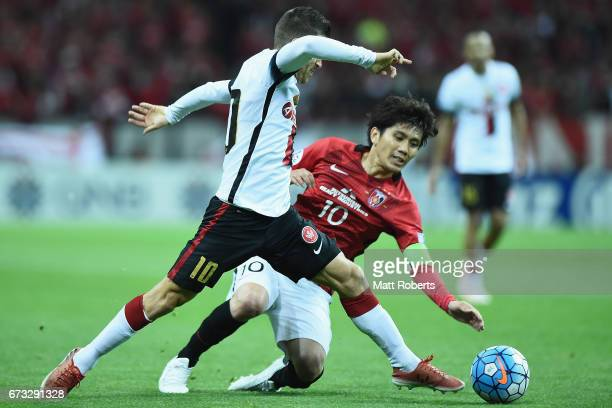 Yosuke Kashiwagi of Urawa Red Diamonds competes for the ball against Nicolas Martinez of Western Sydney Wanderers during the AFC Champions League...