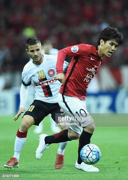 Yosuke Kashiwagi of Urawa Red Diamonds competes for the ball during the AFC Champions League Group F match between Urawa Red Diamonds and Western...