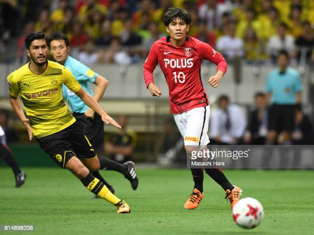 Yosuke Kashiwagi of Urawa Red Diamonds in action during the preseason friendly match between Urawa Red Diamonds and Borussia Dortmund at Saitama...