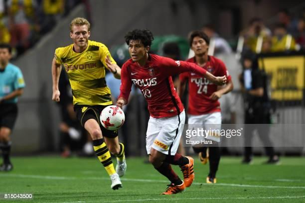 Yosuke Kashiwagi of Urawa Red Diamonds in action during the preseason friendly match between Urawa Red Diamonds and Borussia Dortmund at Saitama...