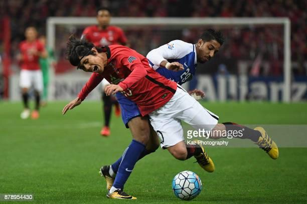 Yosuke Kashiwagi of Urawa Red Diamonds is fouled by Salem Al Dawsari of AlHilal during the AFC Champions League Final second leg match between Urawa...