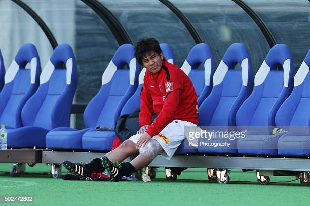Yosuke Kashiwagi of Urawa Red Diamonds is seen on the bench after being replaced due to an injury during the 95th Emperor's Cup semi final match...